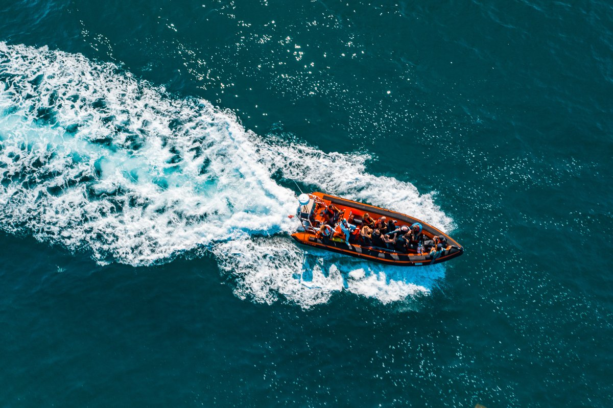 Gallery - Boat taking lucky clients to the Nazaré line up